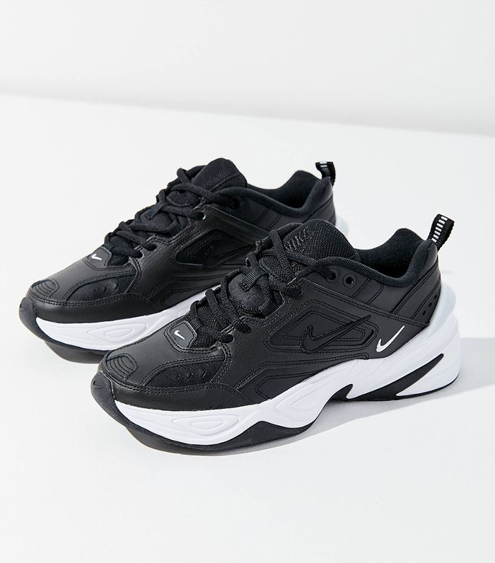 A pair of black Nike M2K Tekno Sneakers with white outsoles.