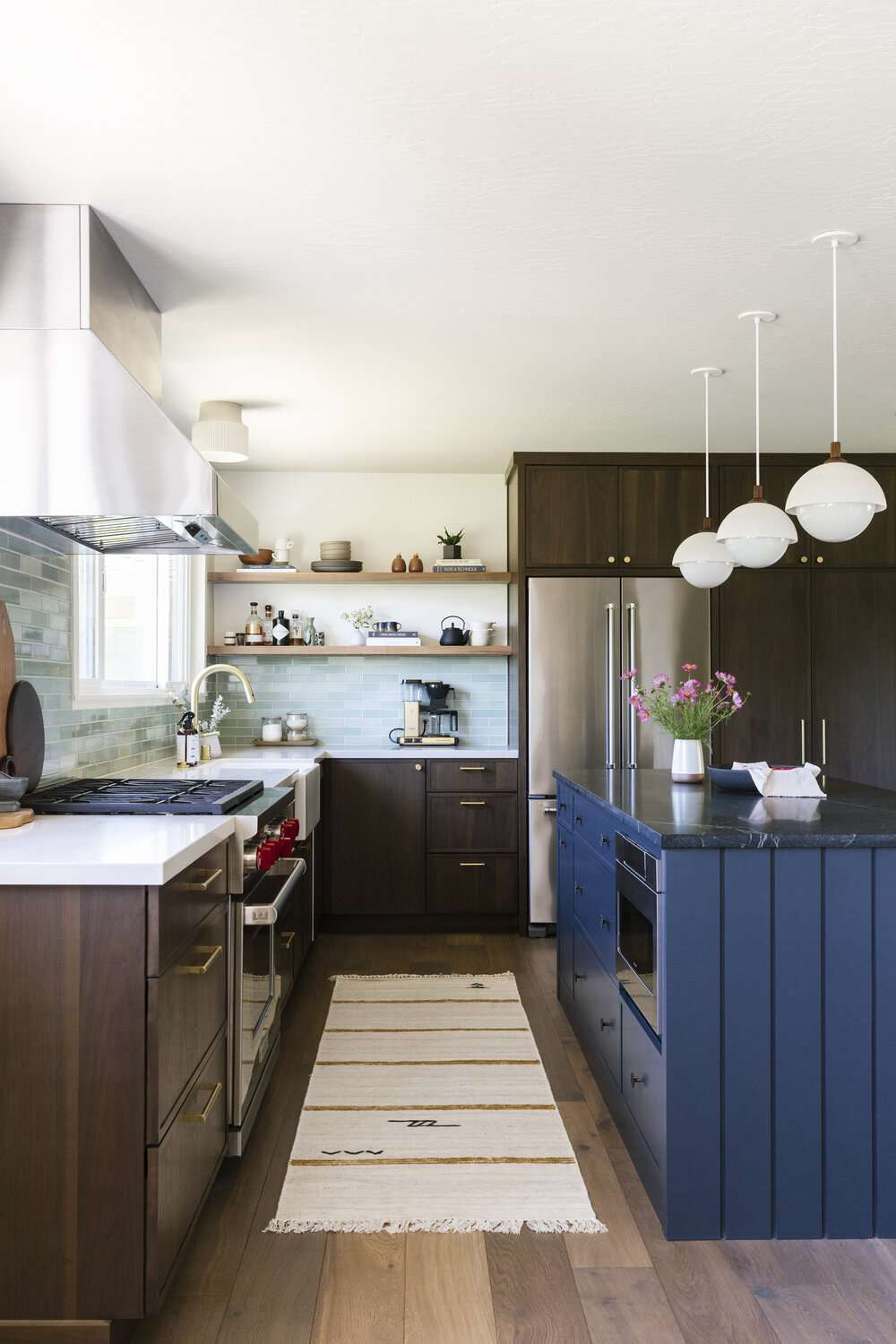 best kitchen ideas - open shelving kitchen with dark cabinets and blue island