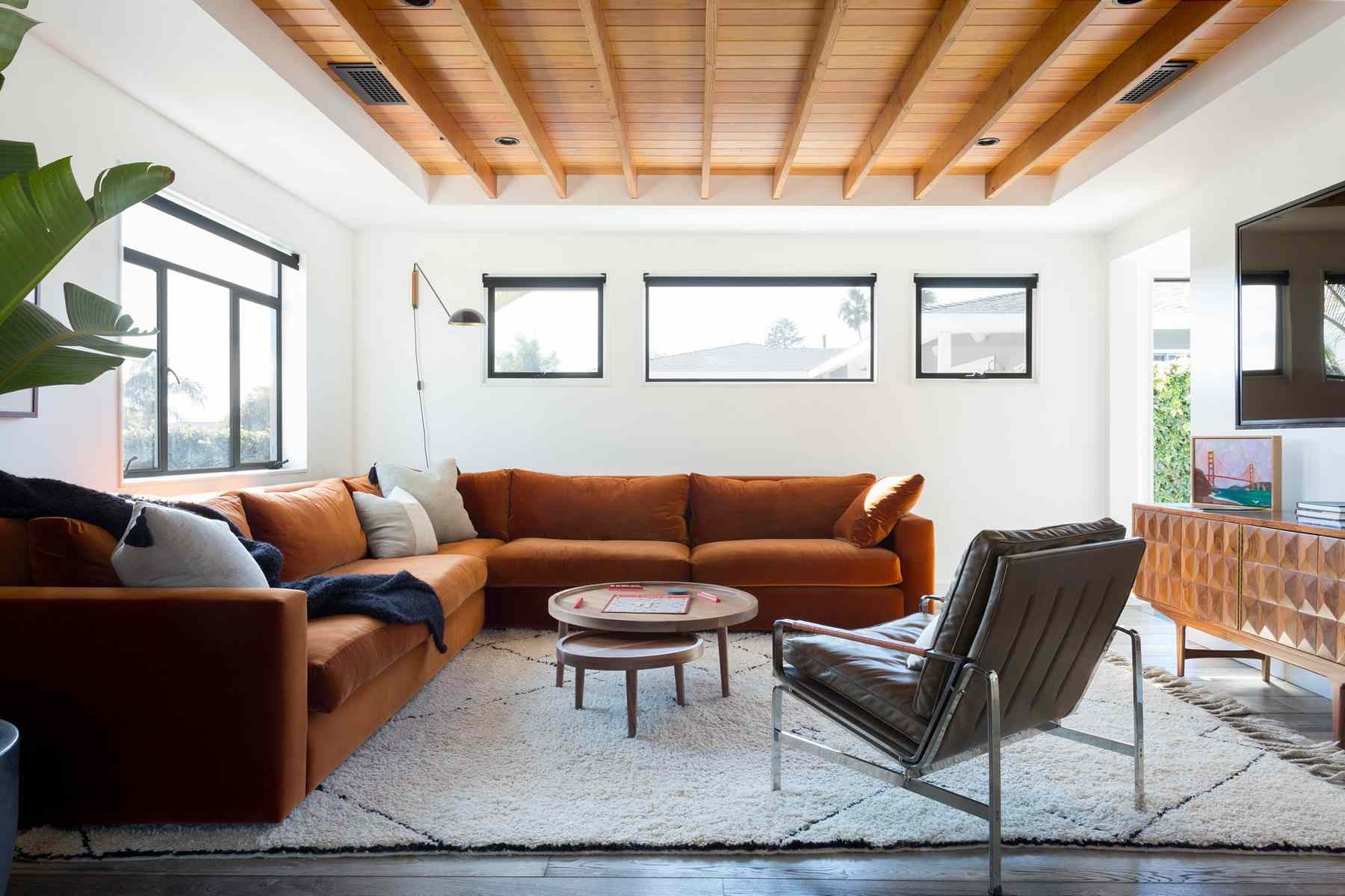 Bright yet cozy living room with an orange velvet sectional