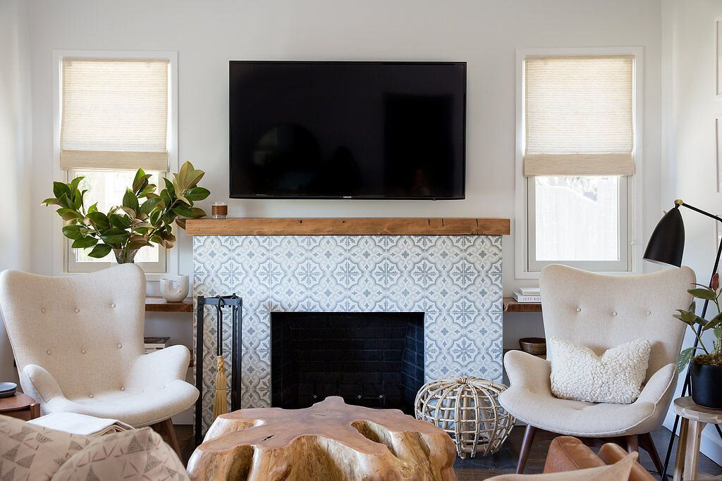 Decoratively tiled fireplace surround in a boho chic living room