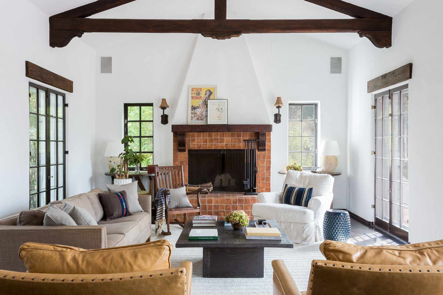 Rustic white living room with wooden beams.