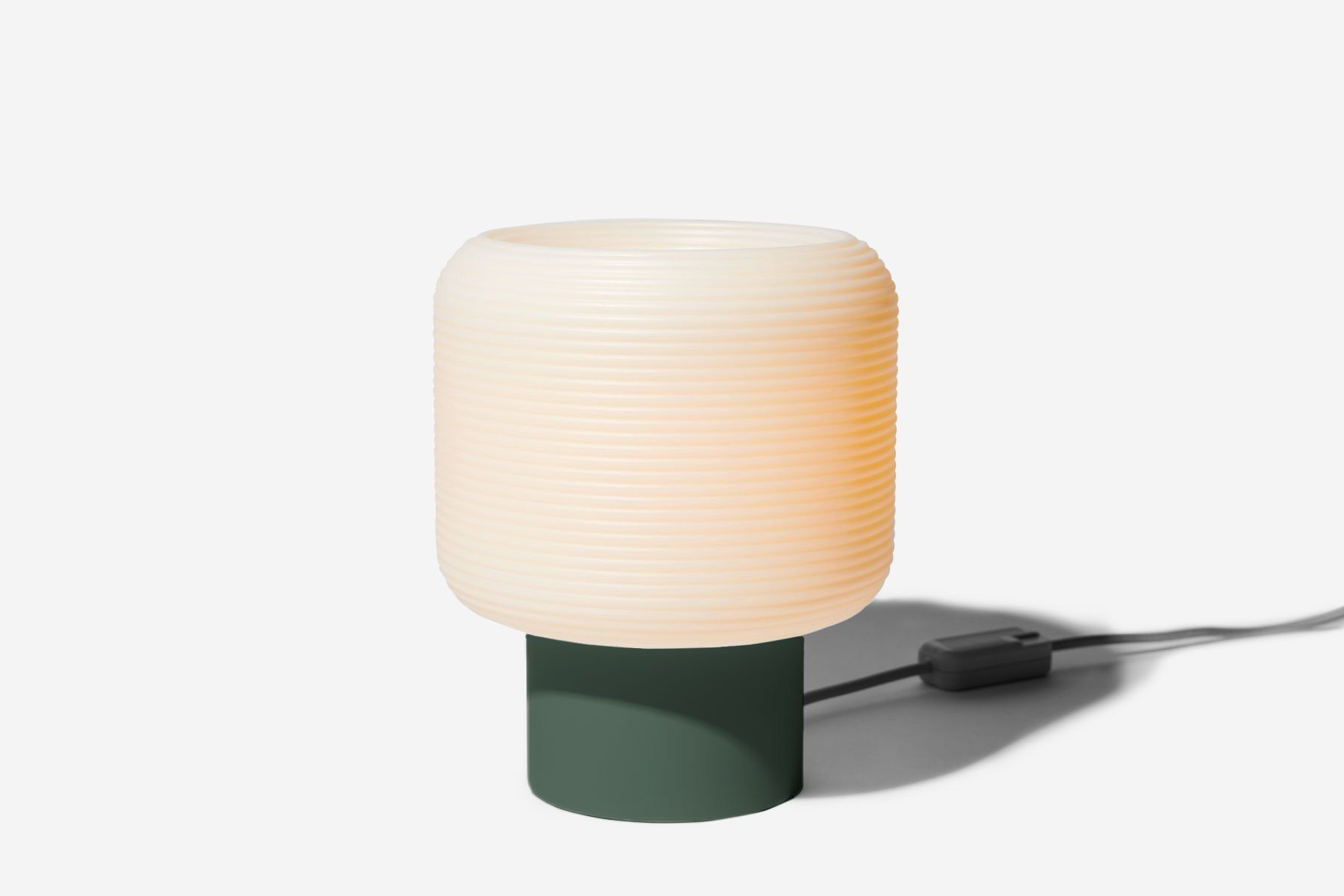 Table lamp with forest green base.