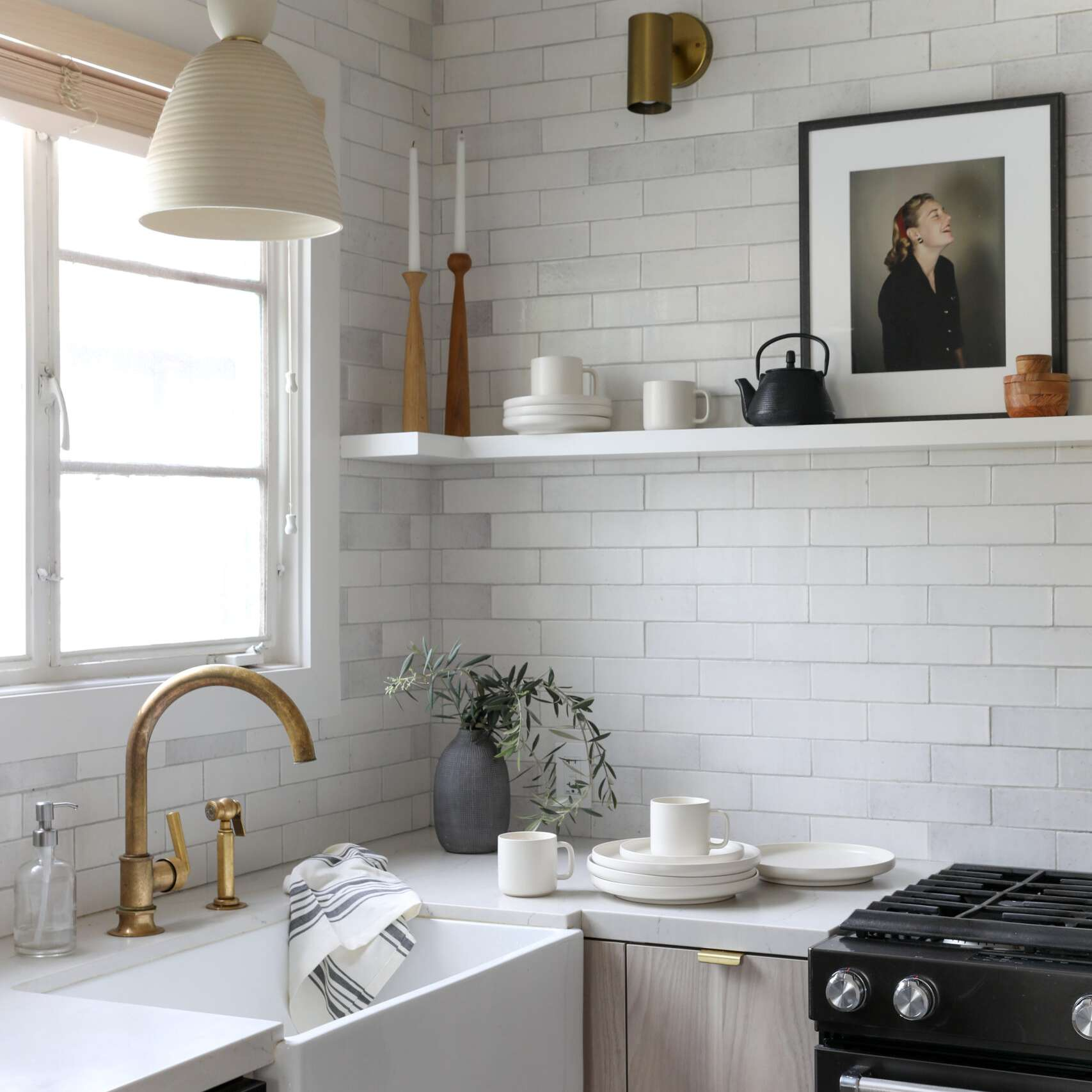 A kitchen corner with a few white plates and bowls