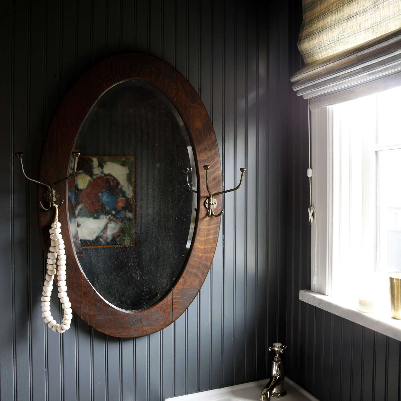 A powder room with dark navy walls