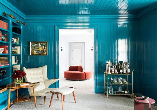 Living room awash in painted blue walls and ceiling