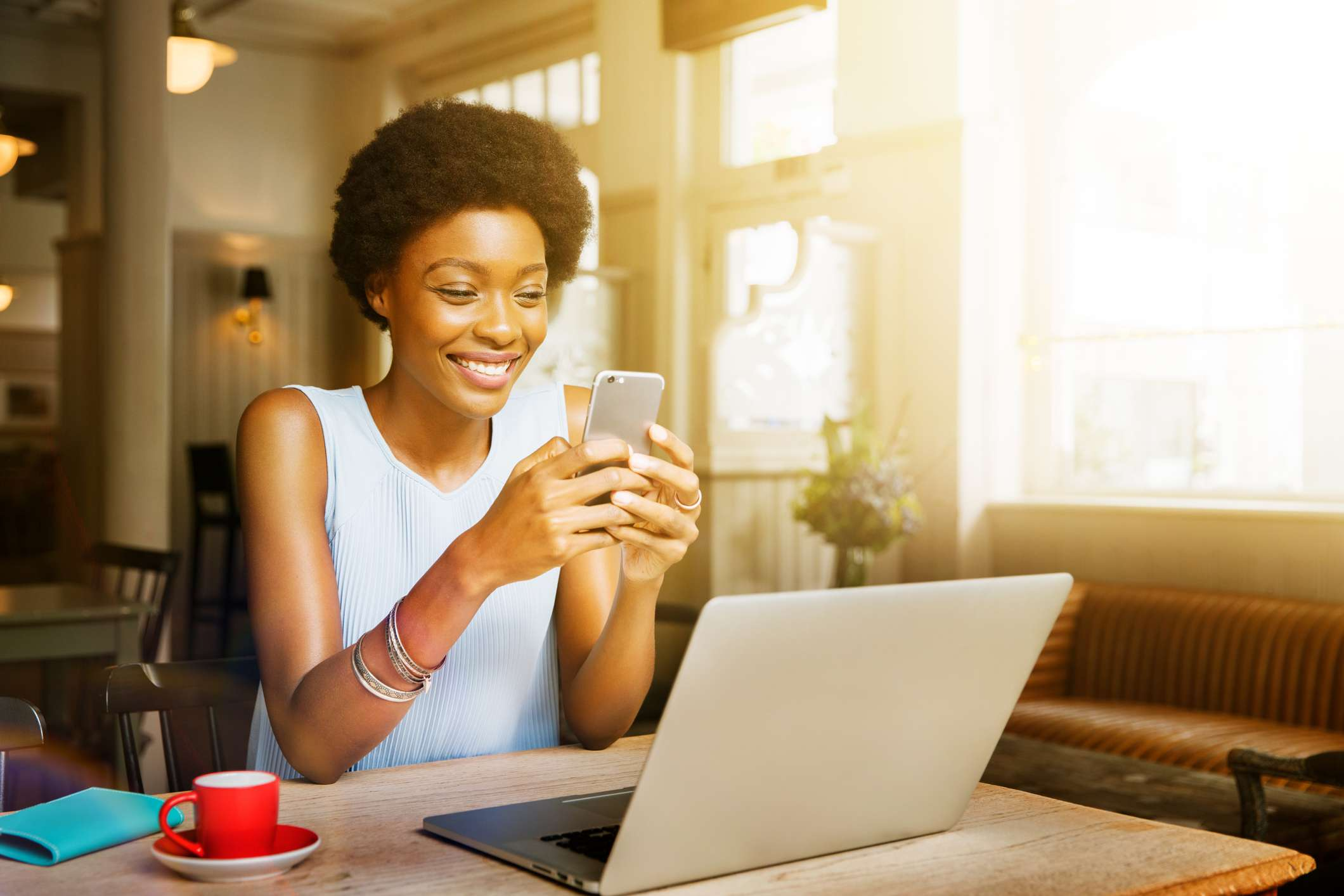 Woman uses smartphone at cafe