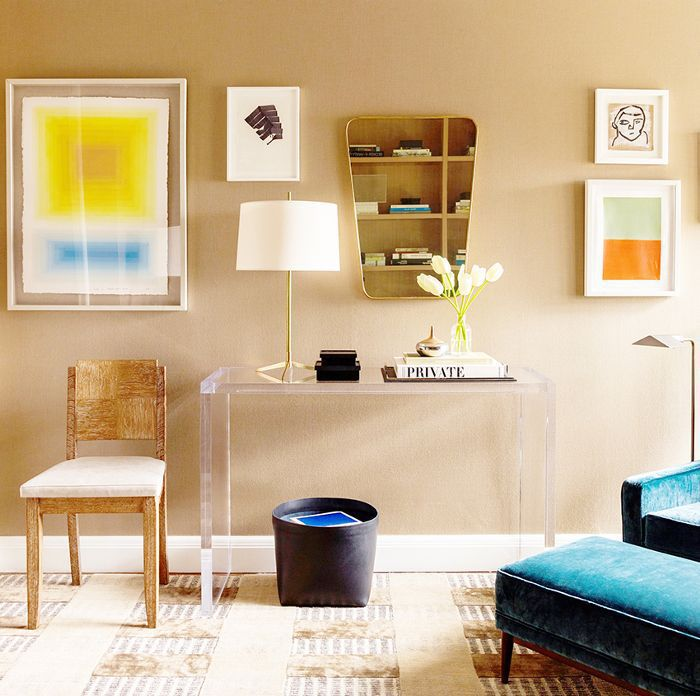 a living room with golden wheat paint