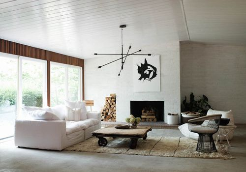 Living room with painted white brick walls