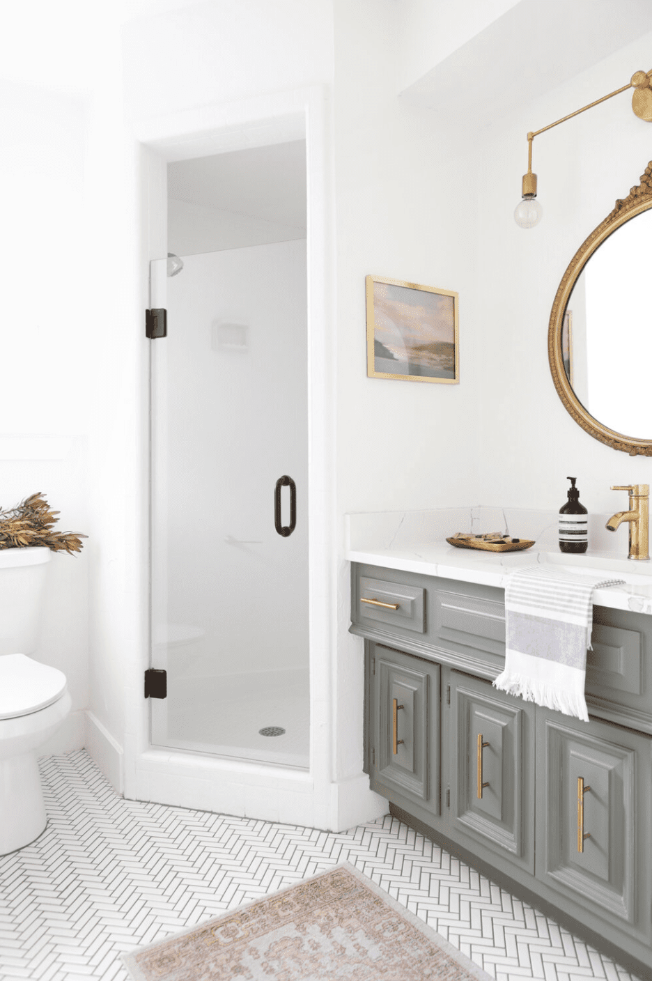 A bathroom with gray cabinets