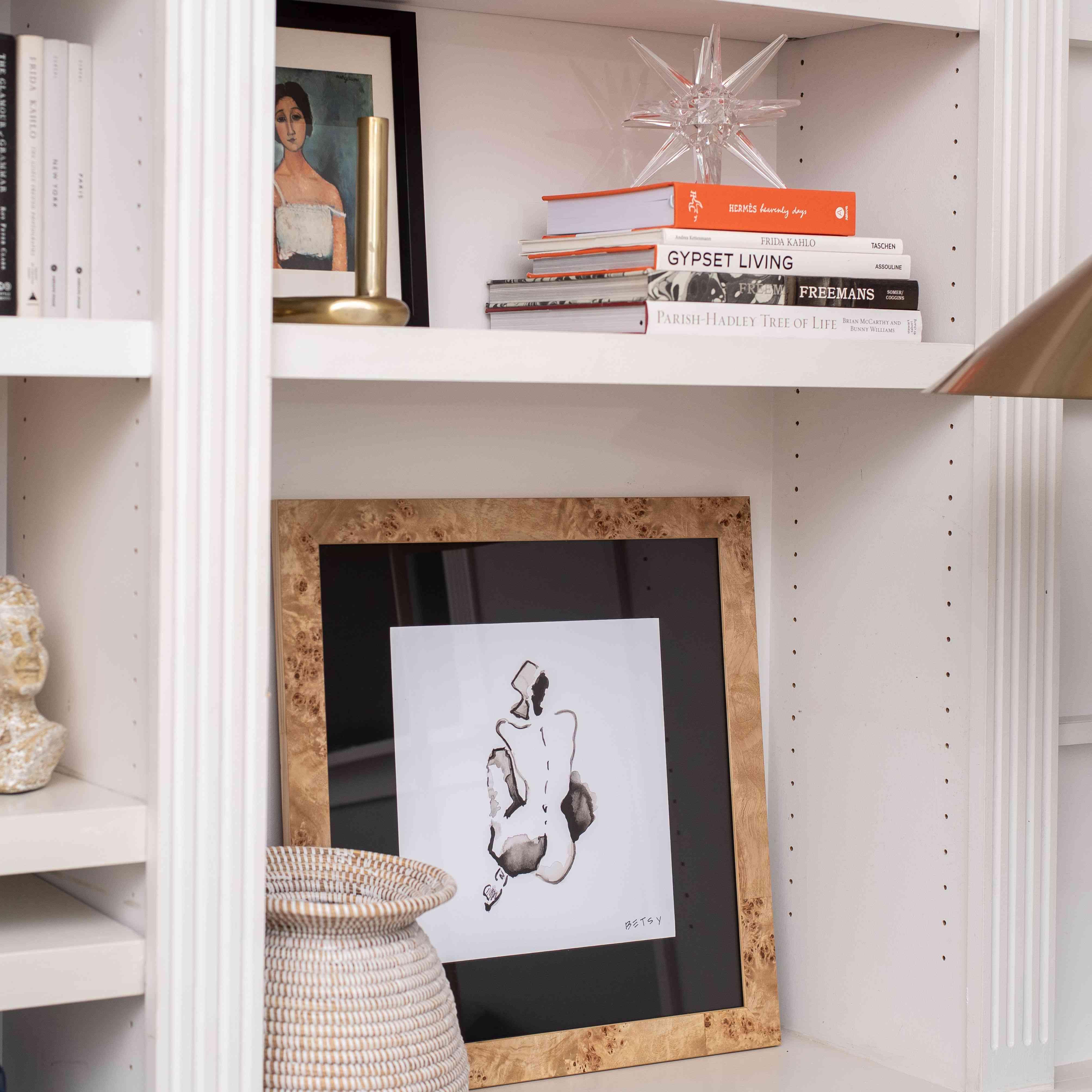 Burl wood frame on shelf.