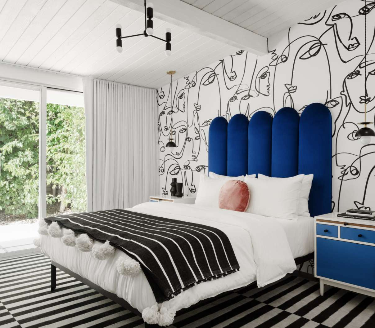 bedroom with mural accent wall