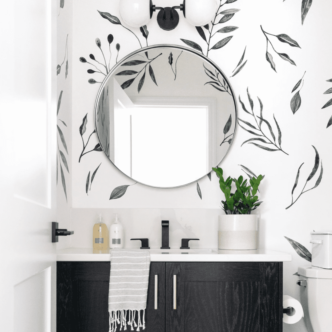 A bathroom with black and white wallpaper
