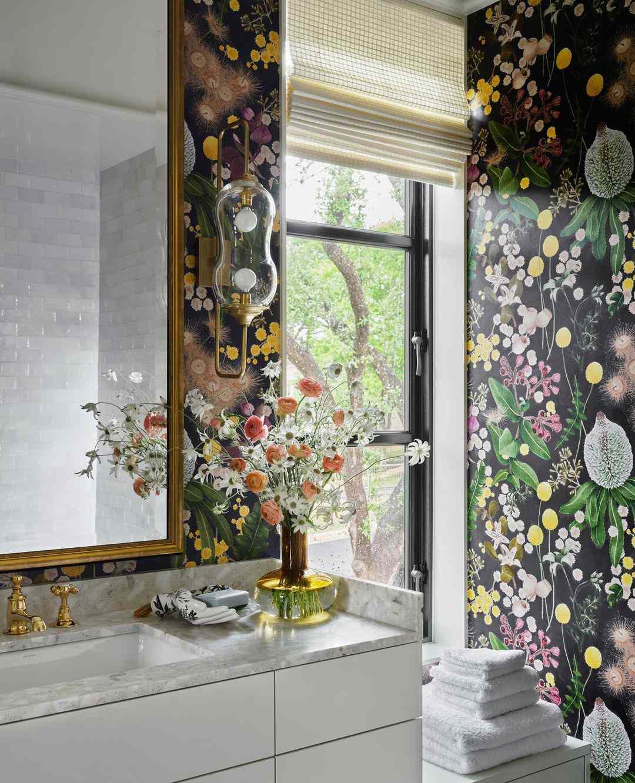 Black floral wallpaper in bathroom.