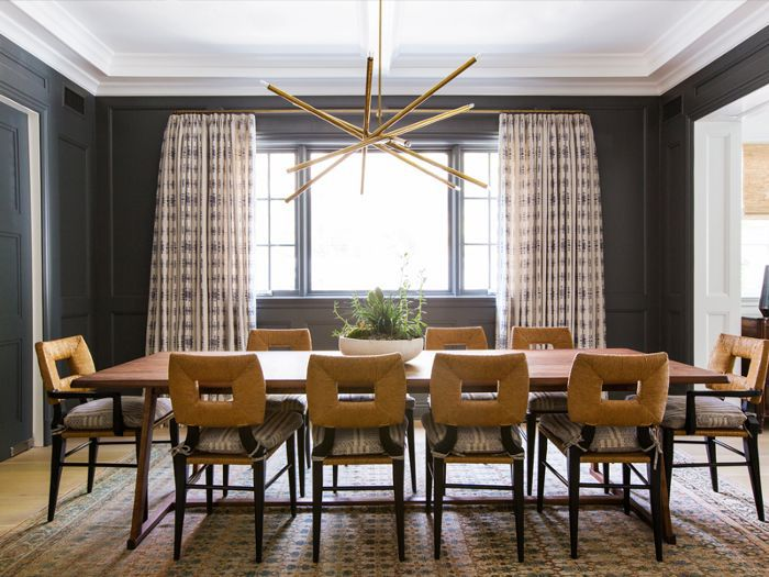 a dining room with black walls
