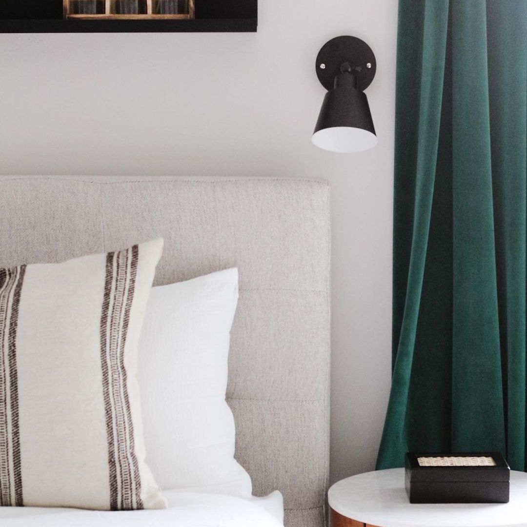 Green and black accented bedroom