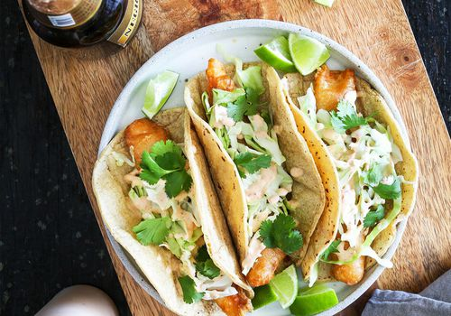 Baja-style crispy fish tacos with chipotle crema