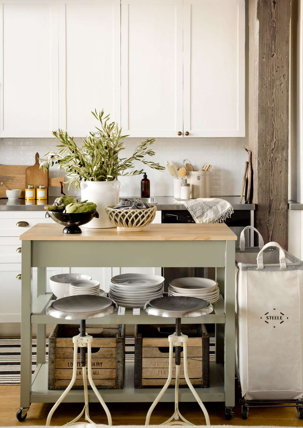 A rustic kitchen with exposed wood beams and other reclaimed wood accents