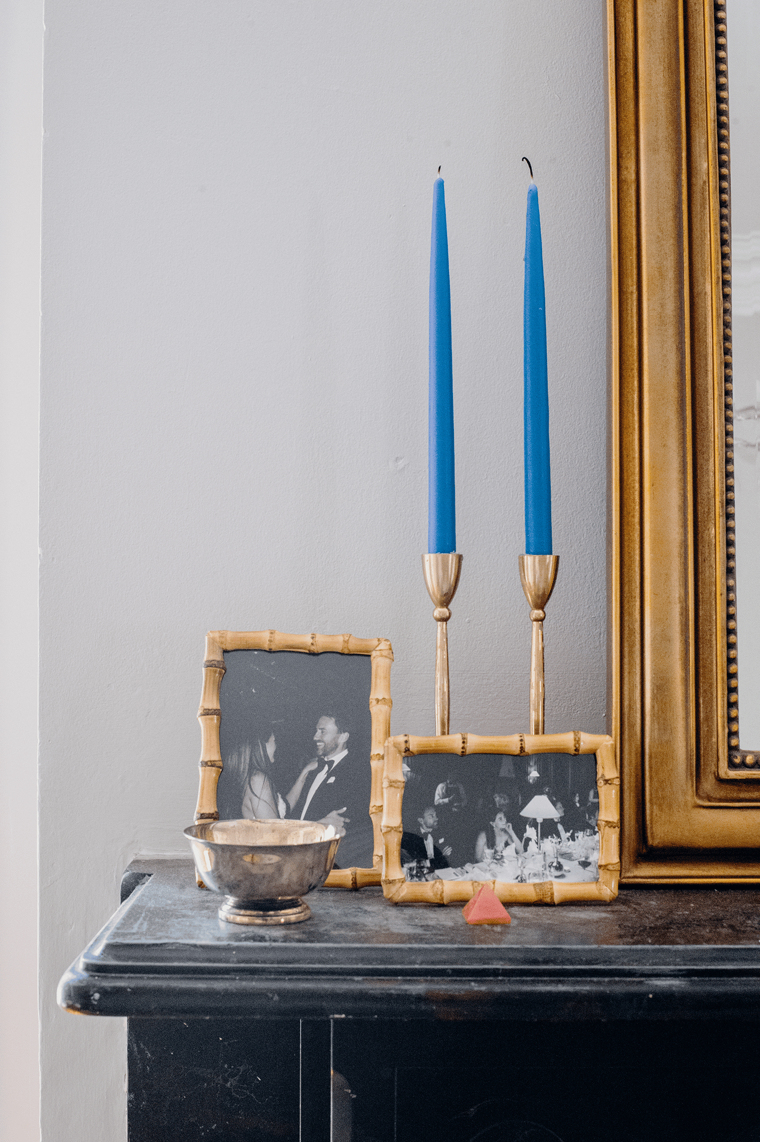 Amanda Greeley home tour - mantel with family photos and trinkets