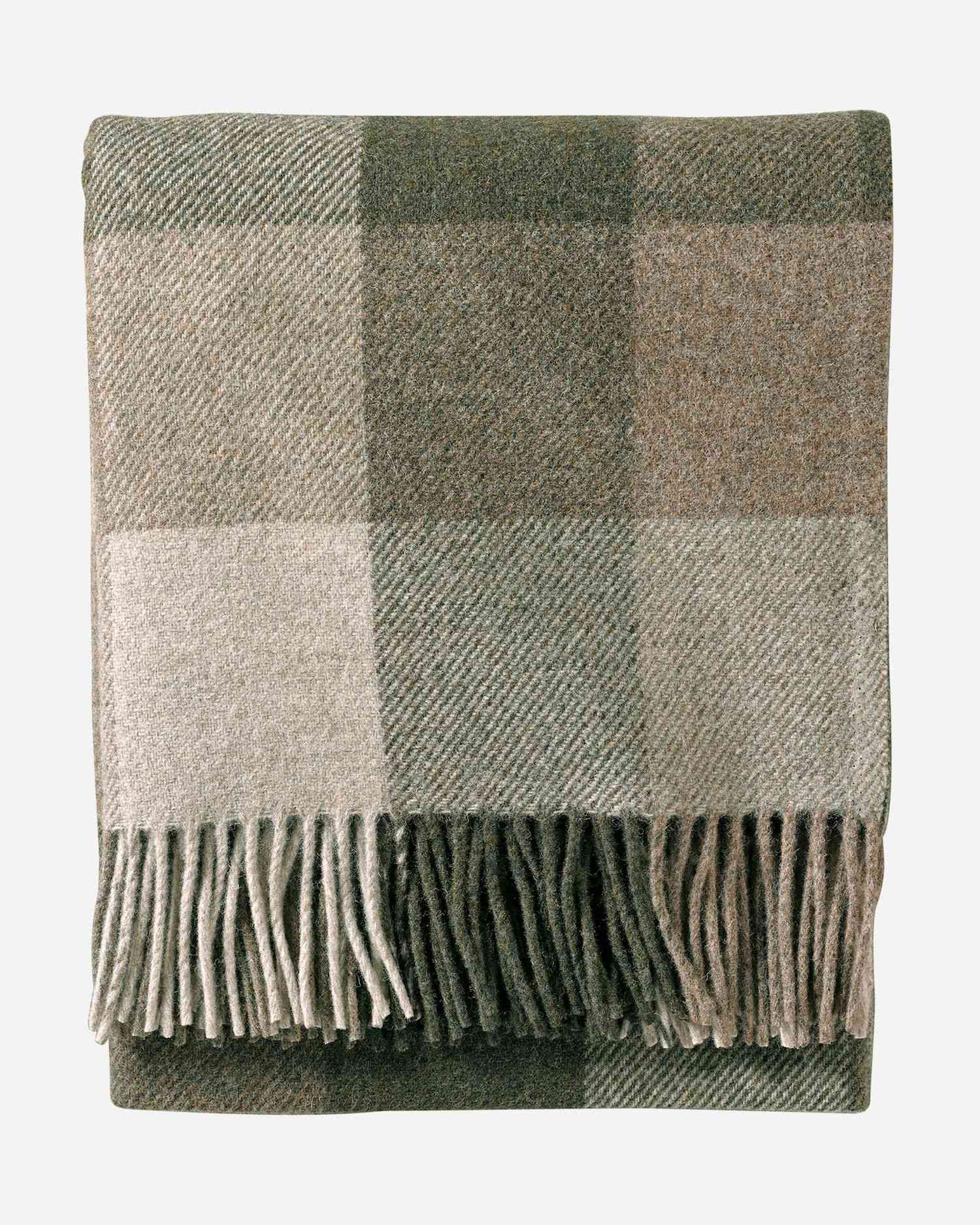 An olive green and beige plaid blanket
