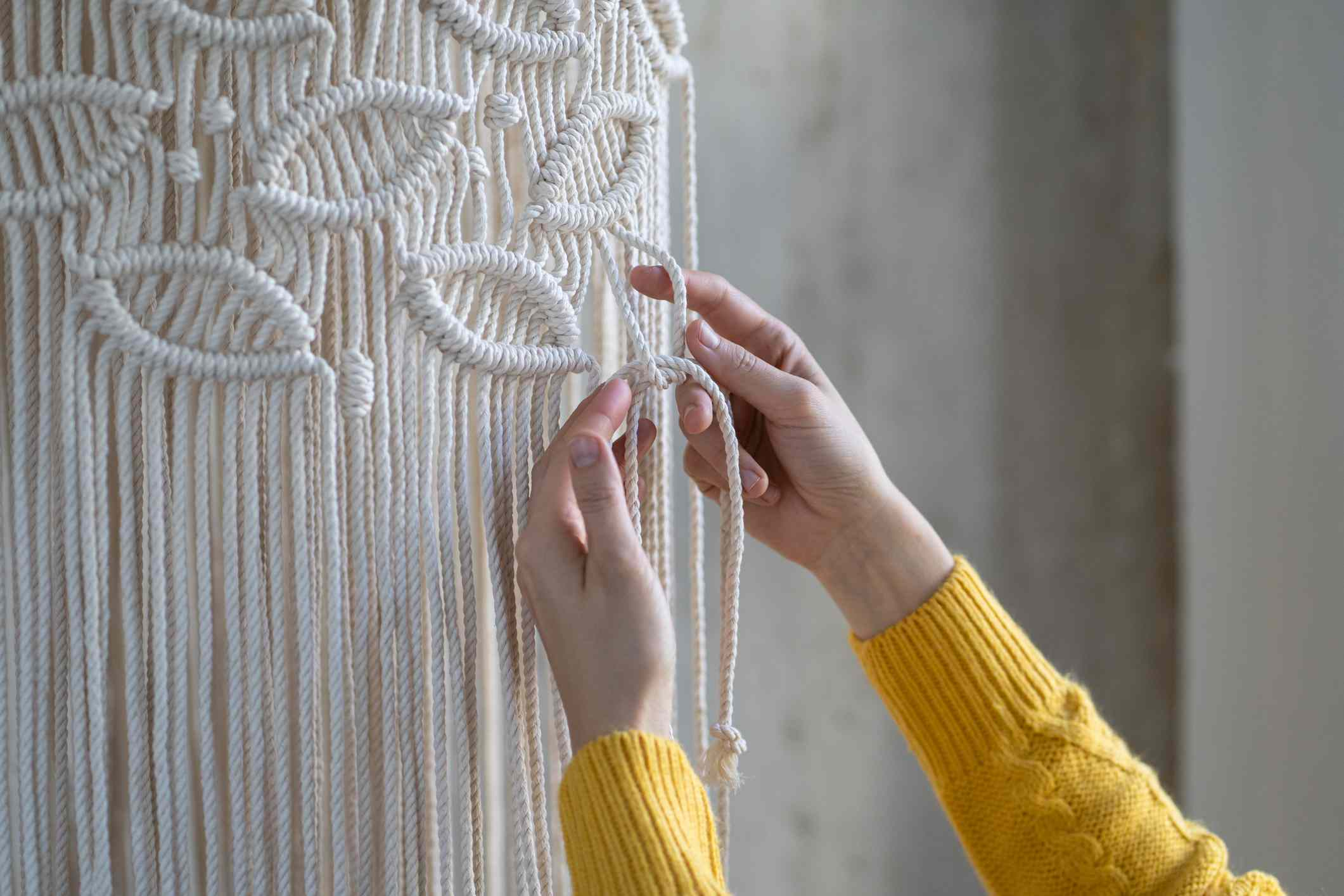 Cropped image of woman doing macrame