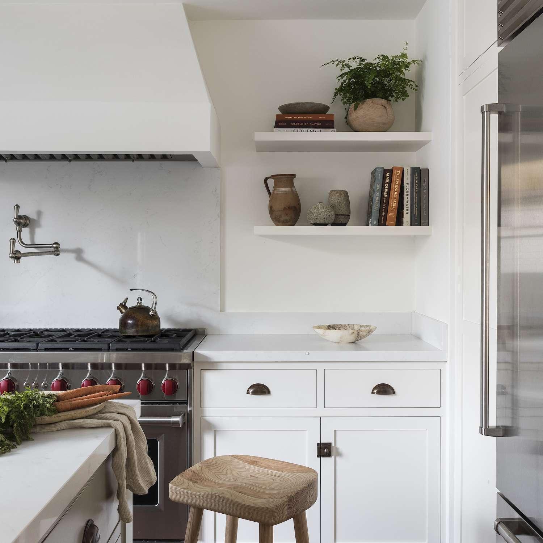 White kitchen with terra cotta tiles