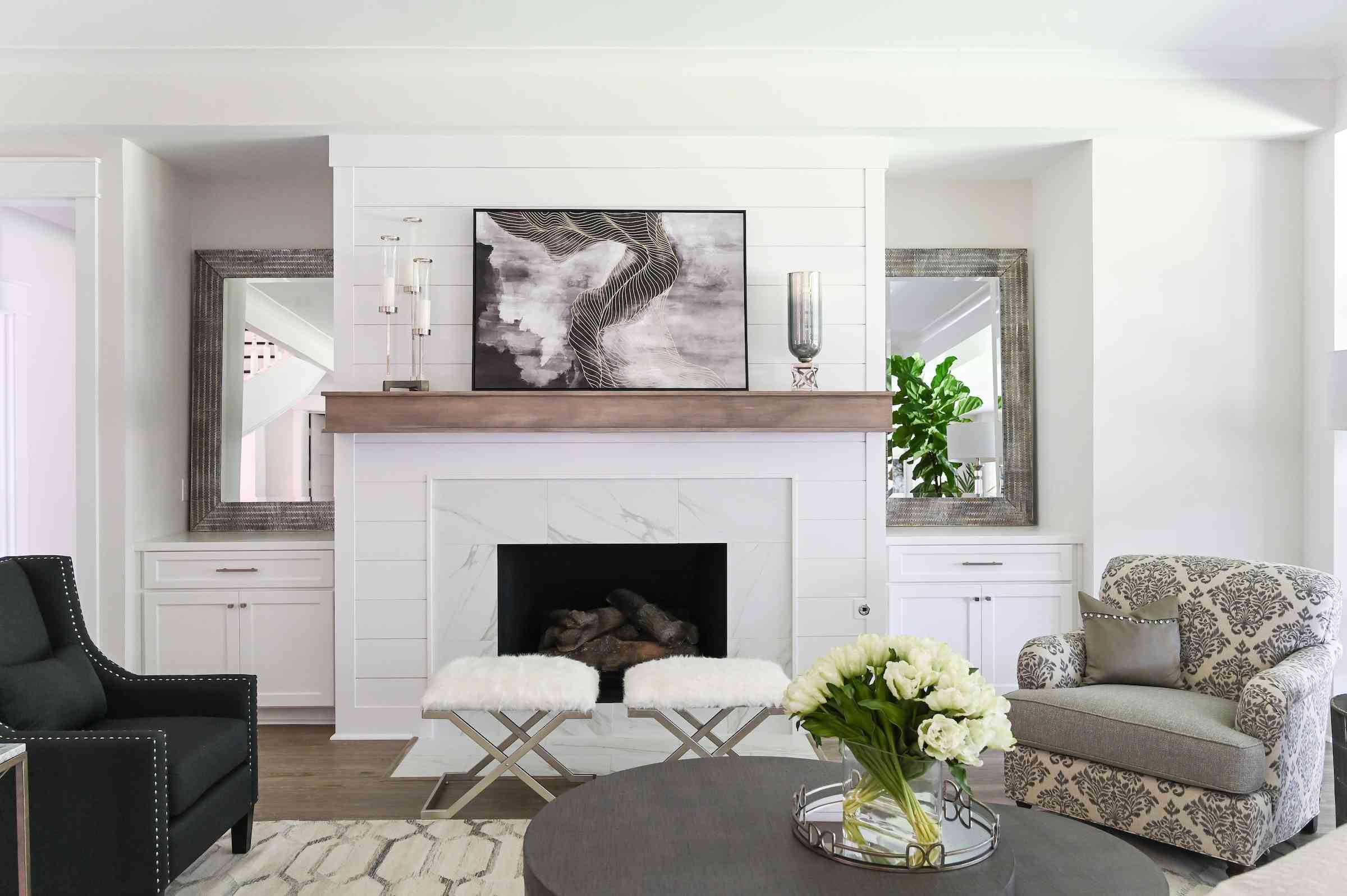 White, clean traditional living room with luxe details.