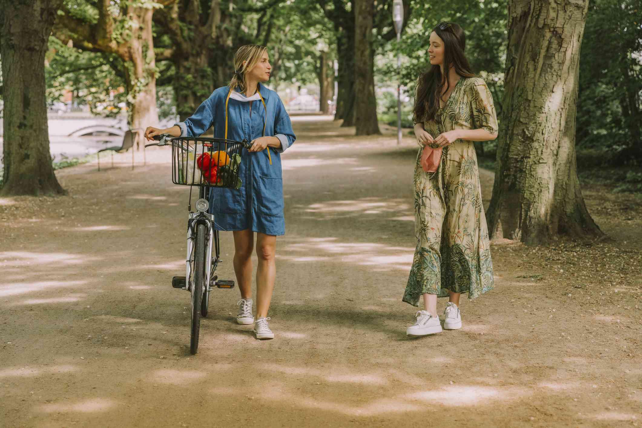 women walking through park