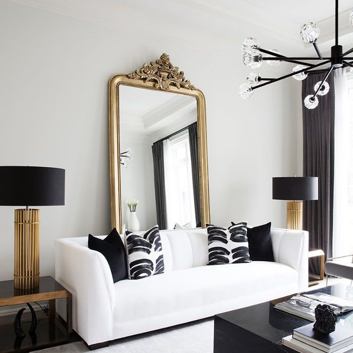 black and white living room—gilded mirror
