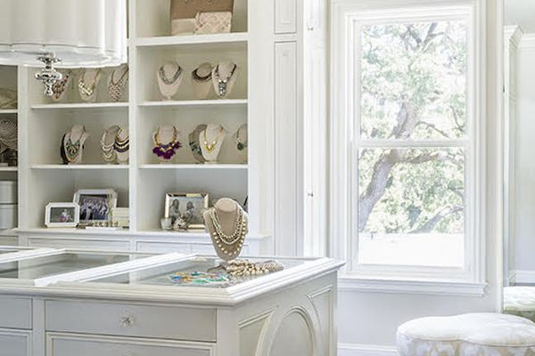 Lovely white closet with jewelry storage.