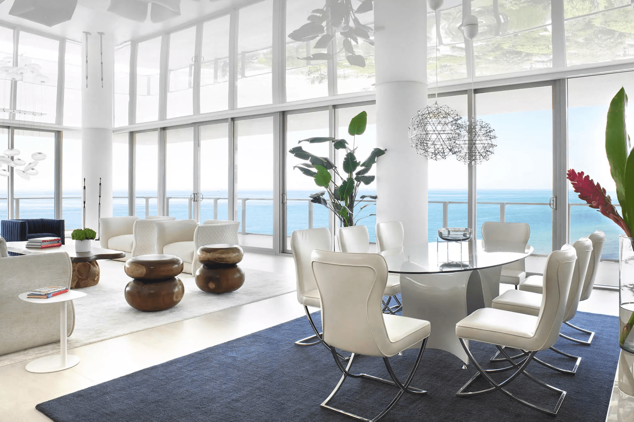 An open-concept space filled with white and ivory pieces