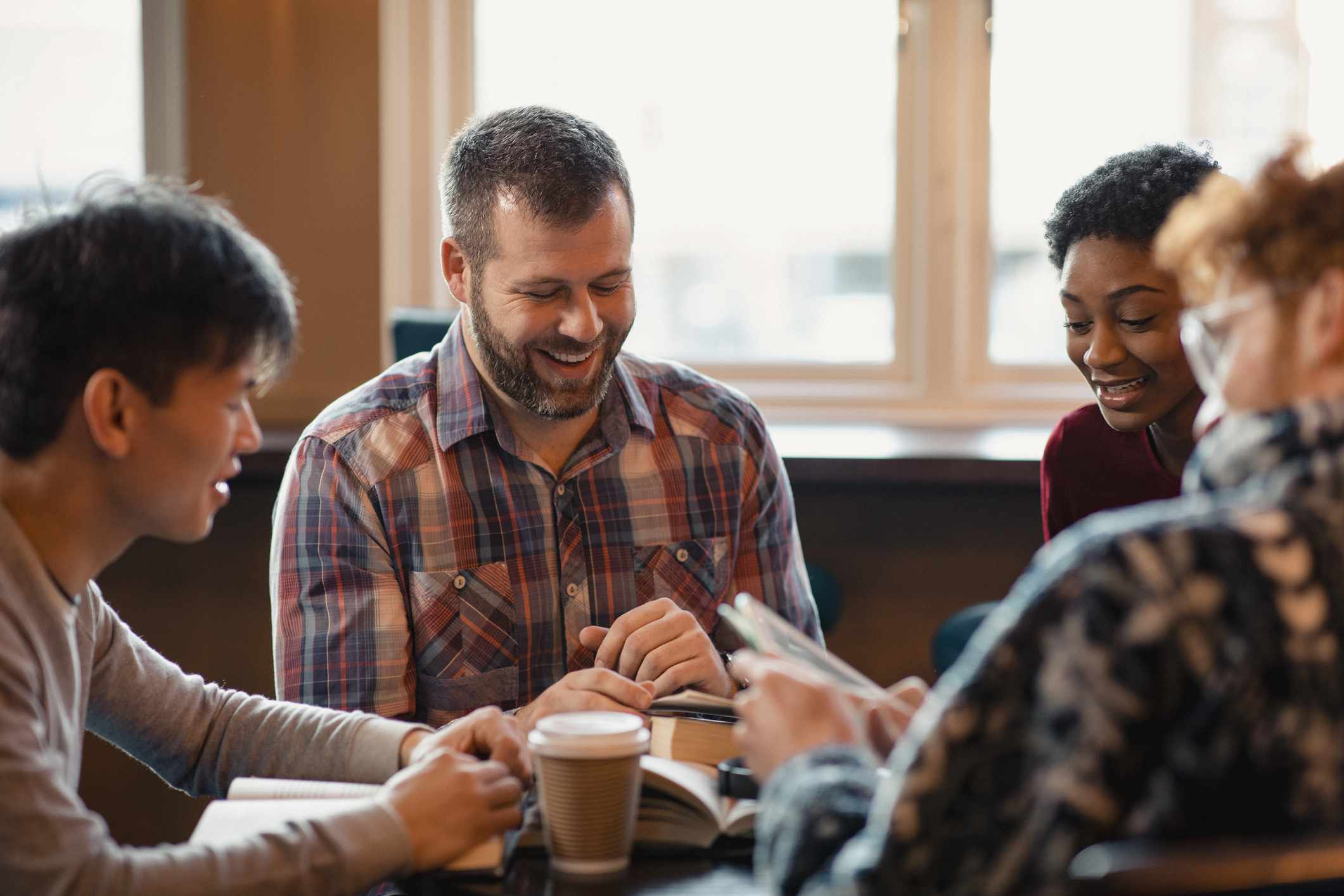 Small group discusses a book