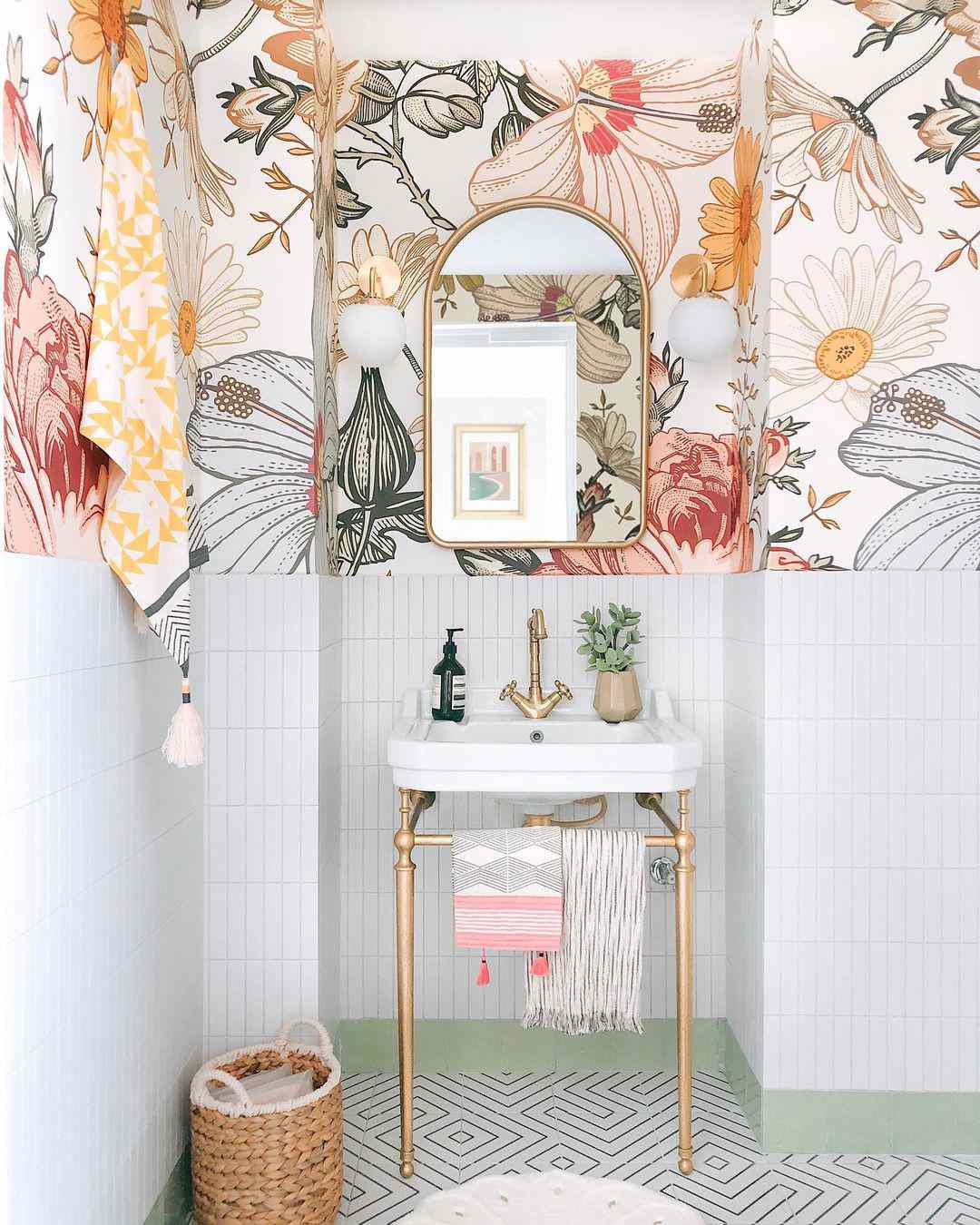bathroom with floral wallpaper and gold mirror