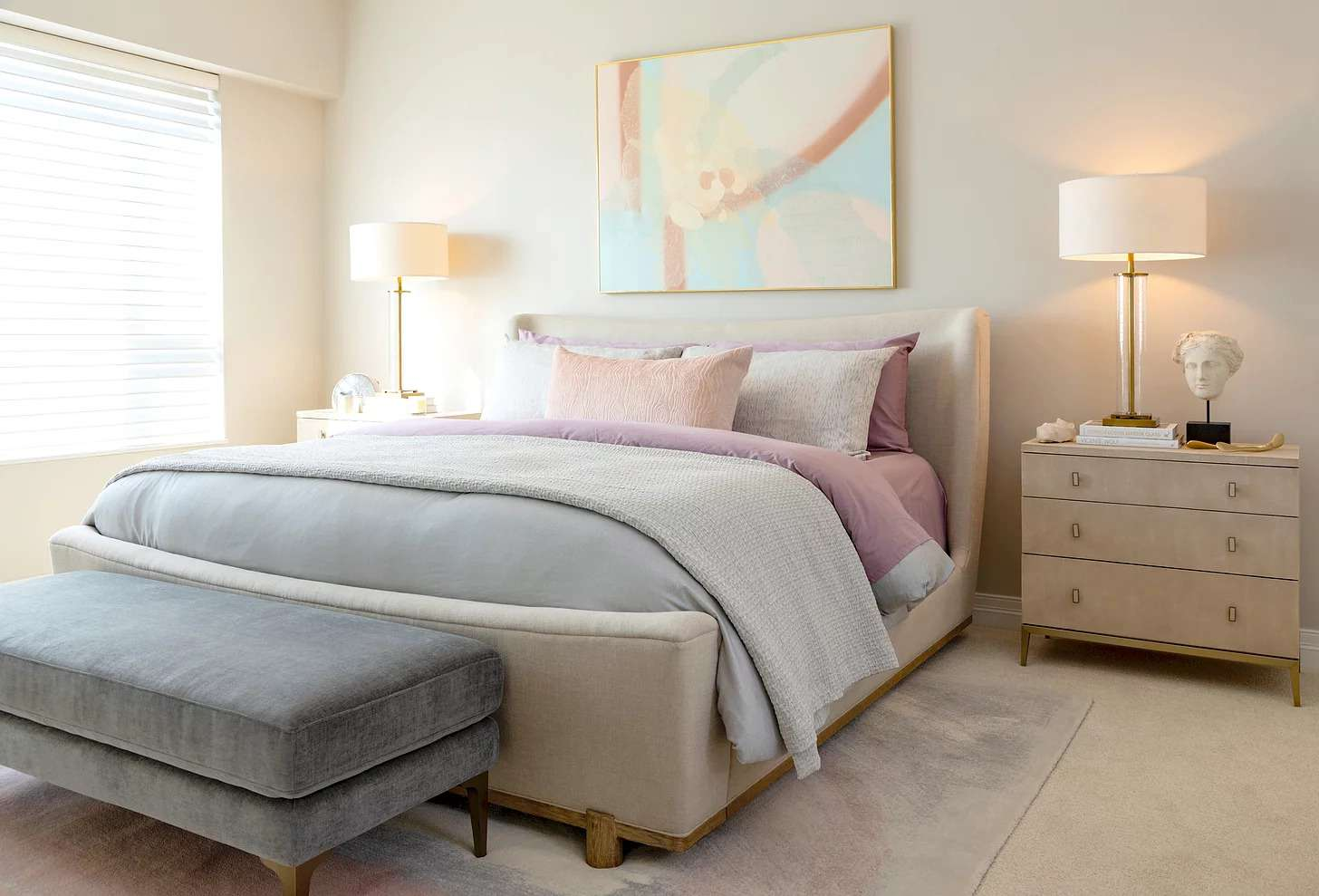 A modern bedroom with pink accents.