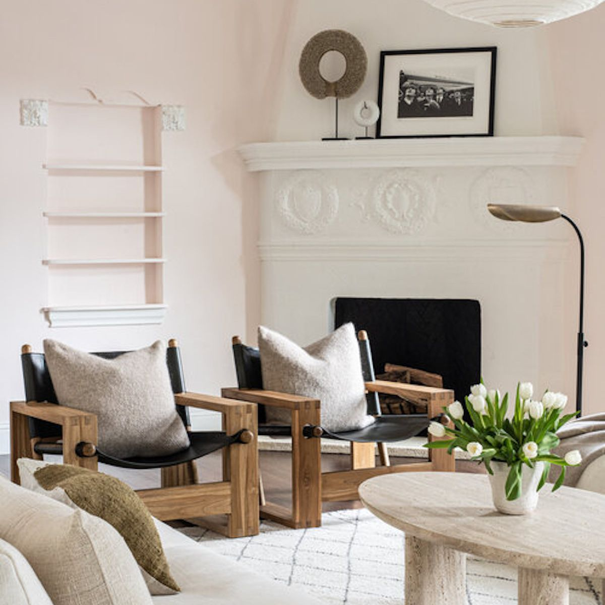 Fresh white tulips on living room coffee table