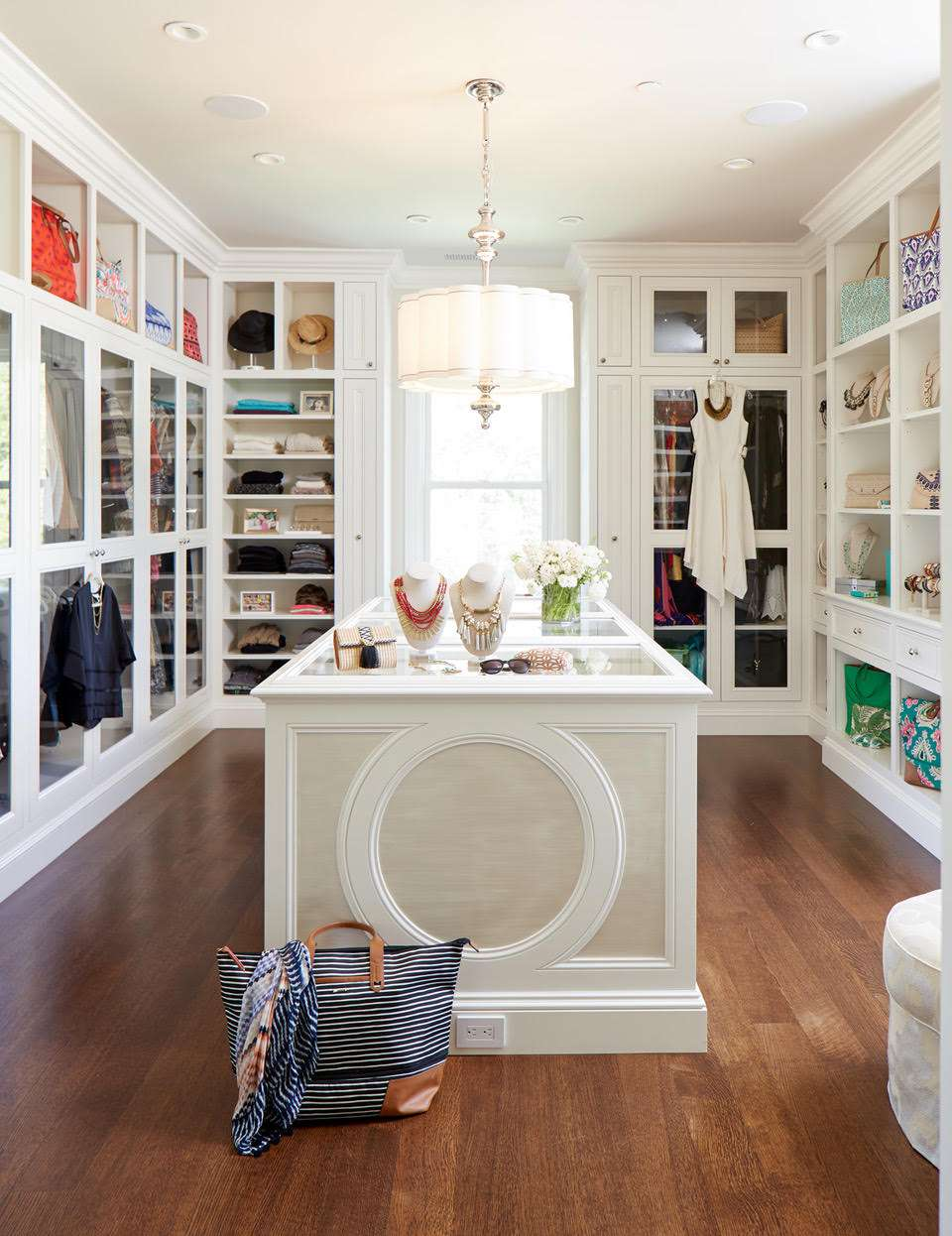 Large closet with jewelry on display.