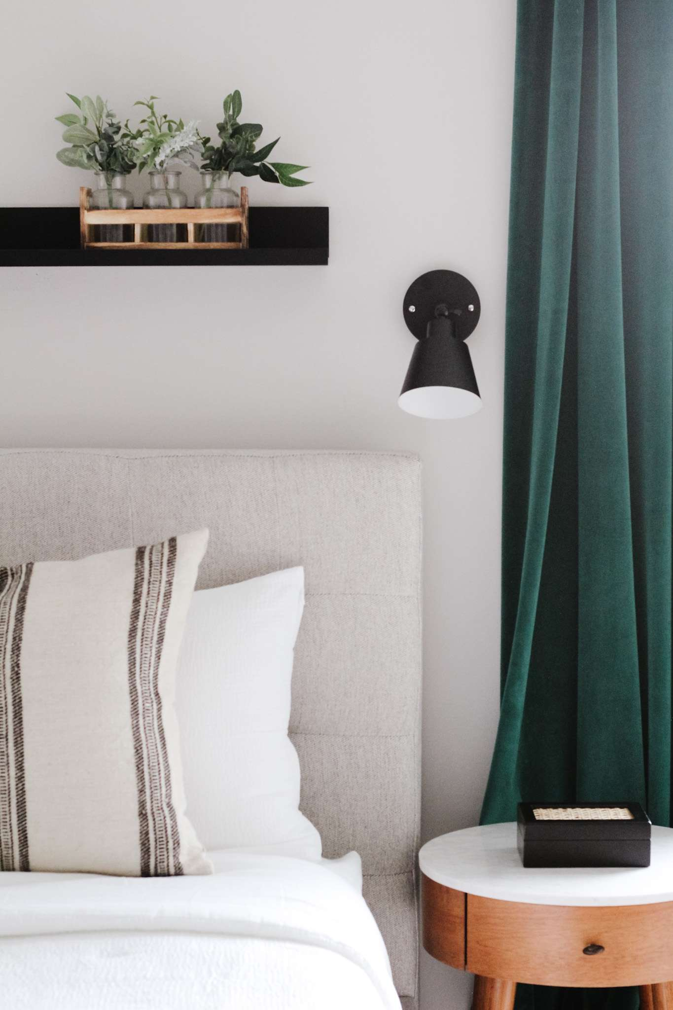 Bedroom with a sconce