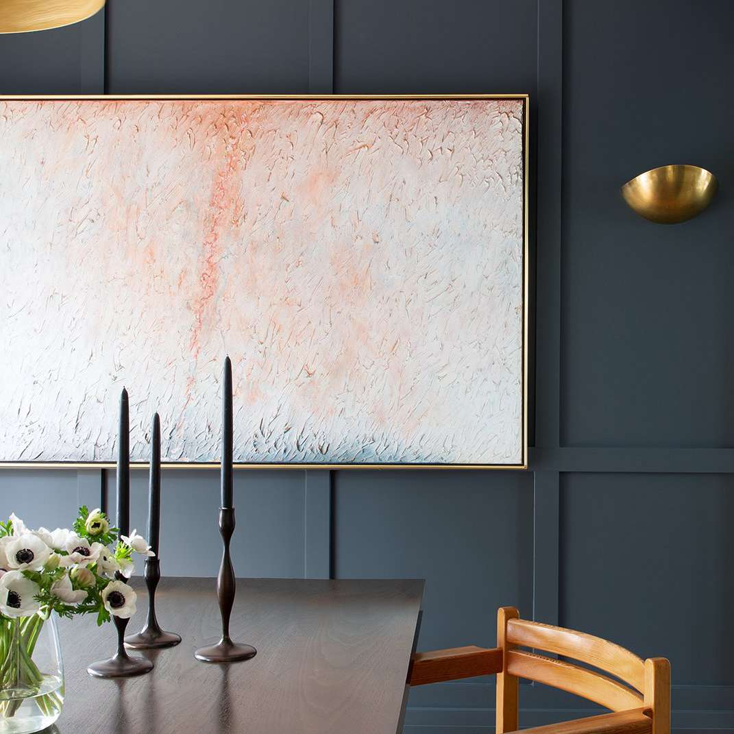 Dining room with large abstract painting