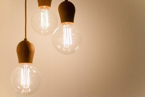 set of three lit light bulbs