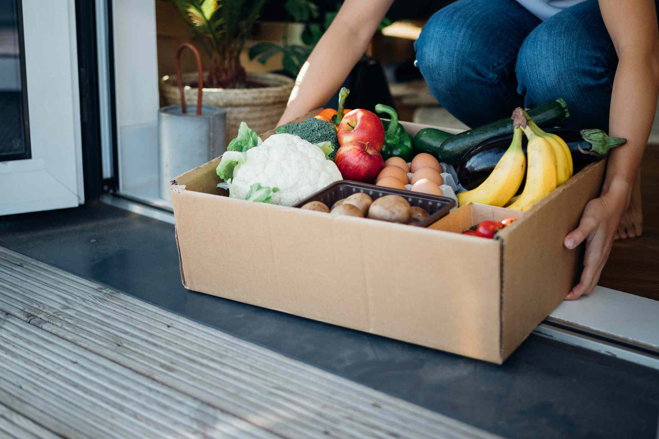 Woman receives fresh food delivery