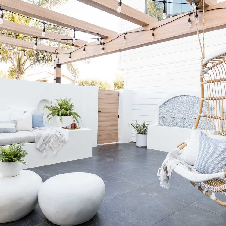 Outdoor living space with a hanging basket chair
