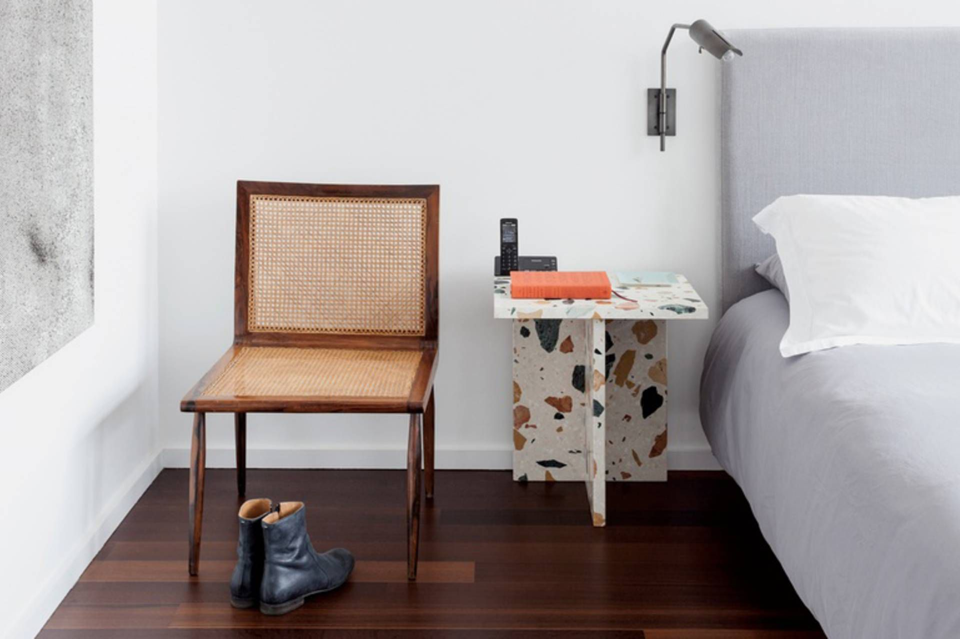 Terrazzo side table next to bed.