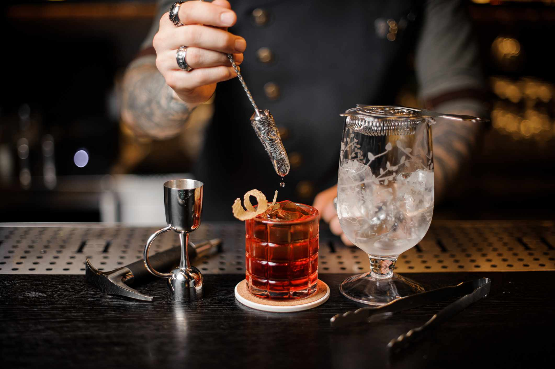 Bartender makes an Old Fashion cocktail