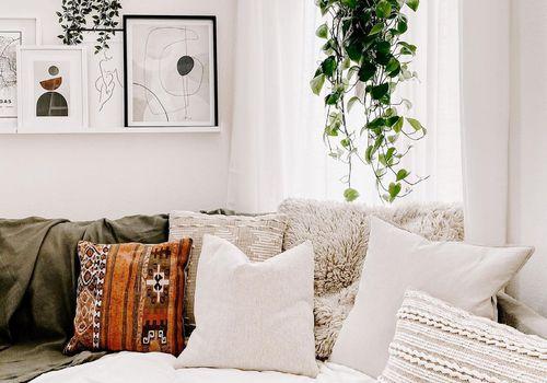 Boho Scandi living room with hanging plant.