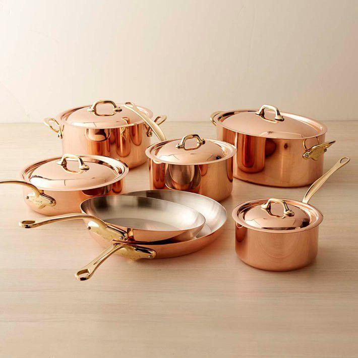 A 12-piece copper-colored cookware set