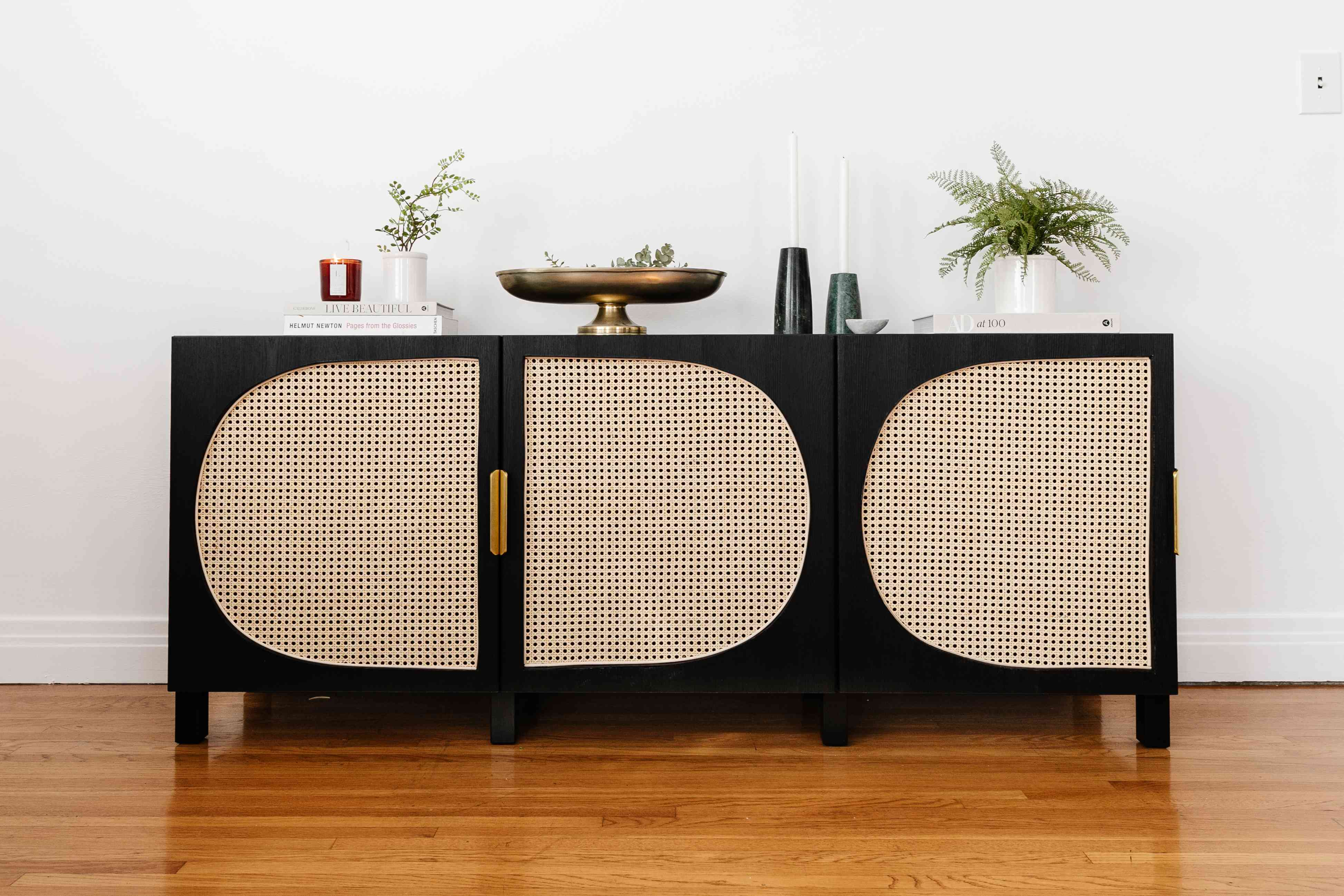 lone fox media unit - with cane backing styled with books and plants