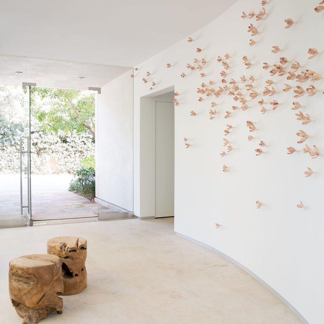 Pink floral wall art installation