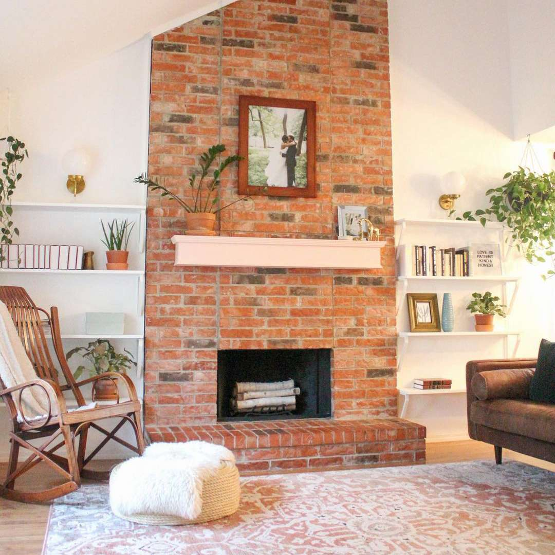 unused fireplace with brightly painted mantel