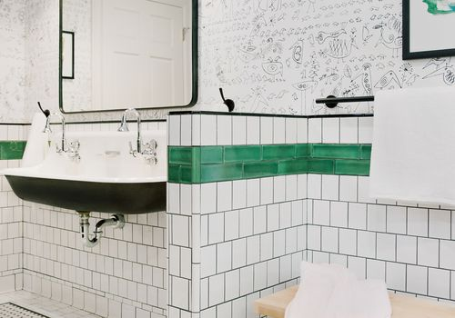 Gym locker inspired bathroom with white tile