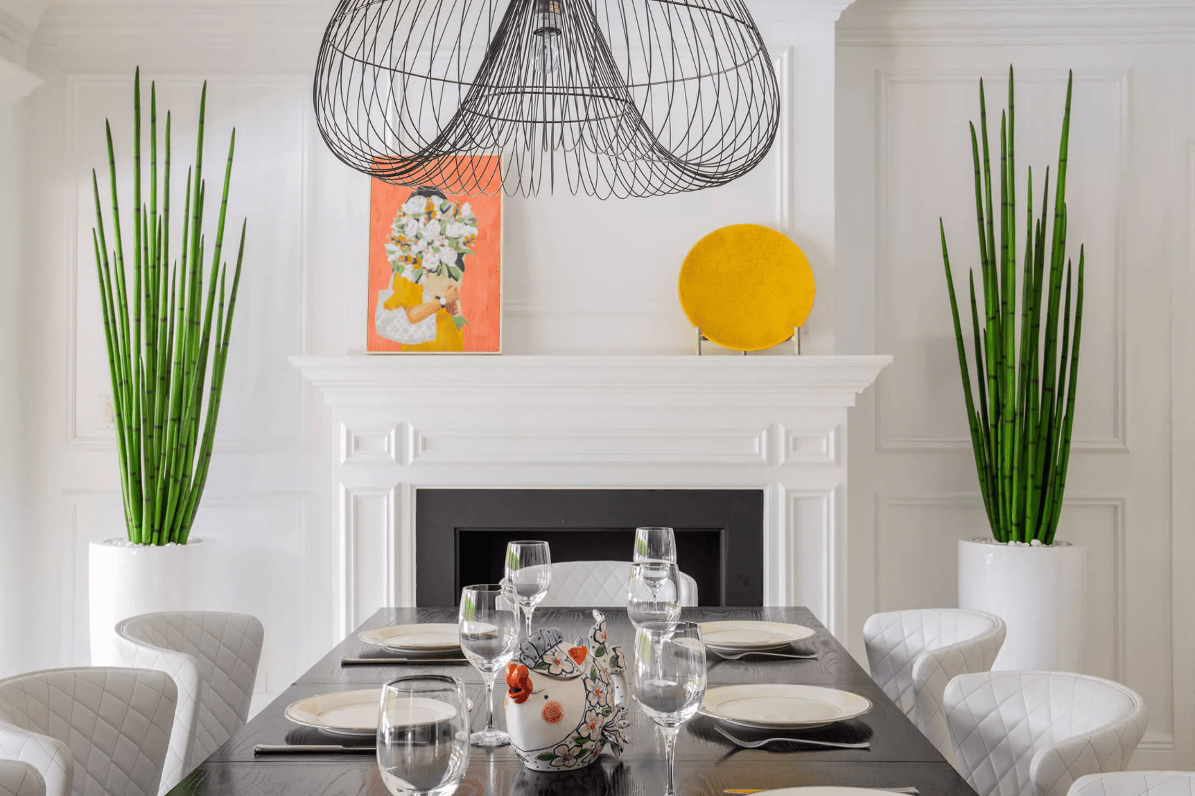 A white room with orange, yellow, and green accents
