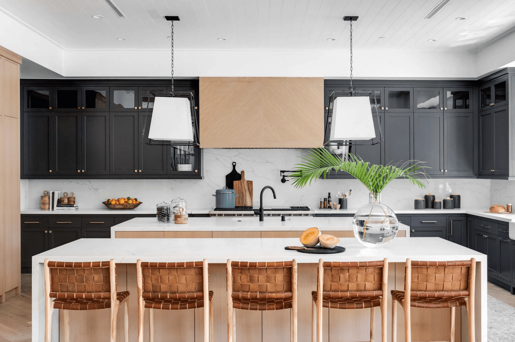 A kitchen with two different kitchen islands
